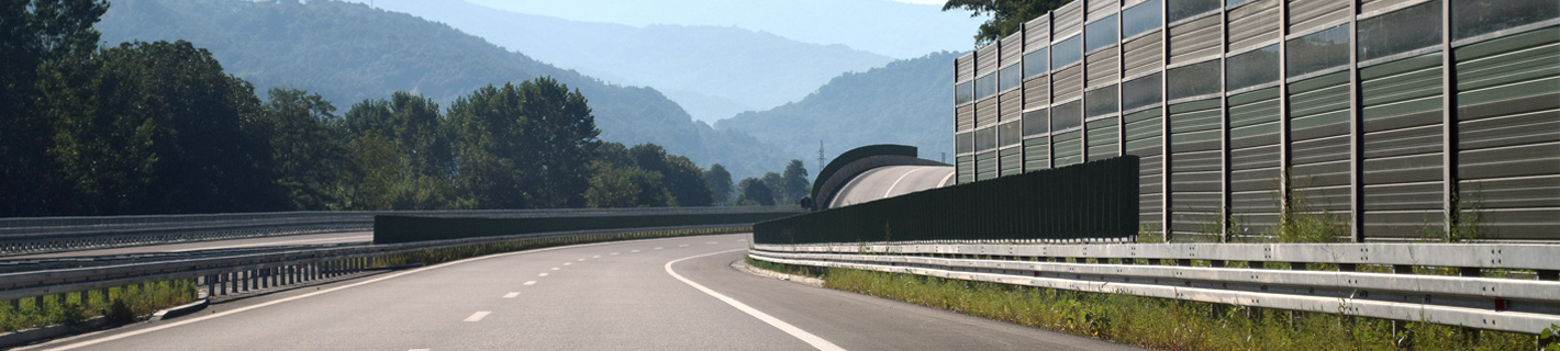 Highway with noise barrier.